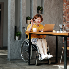 woman on laptop in wheelchair